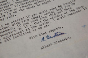 A letter from Nobel Prize-winning physicist Albert Einstein is seen at a Jerusalem auction house on June 20, 2017..Five letters from Albert Einstein giving colleagues his thoughts on physics, God and Israel in the 1950s went under the hammer at the Jerusalem auction house. / AFP PHOTO / GIL COHEN-MAGEN